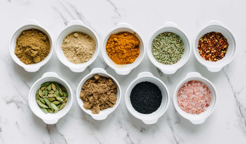 Spices In Small White Containers
