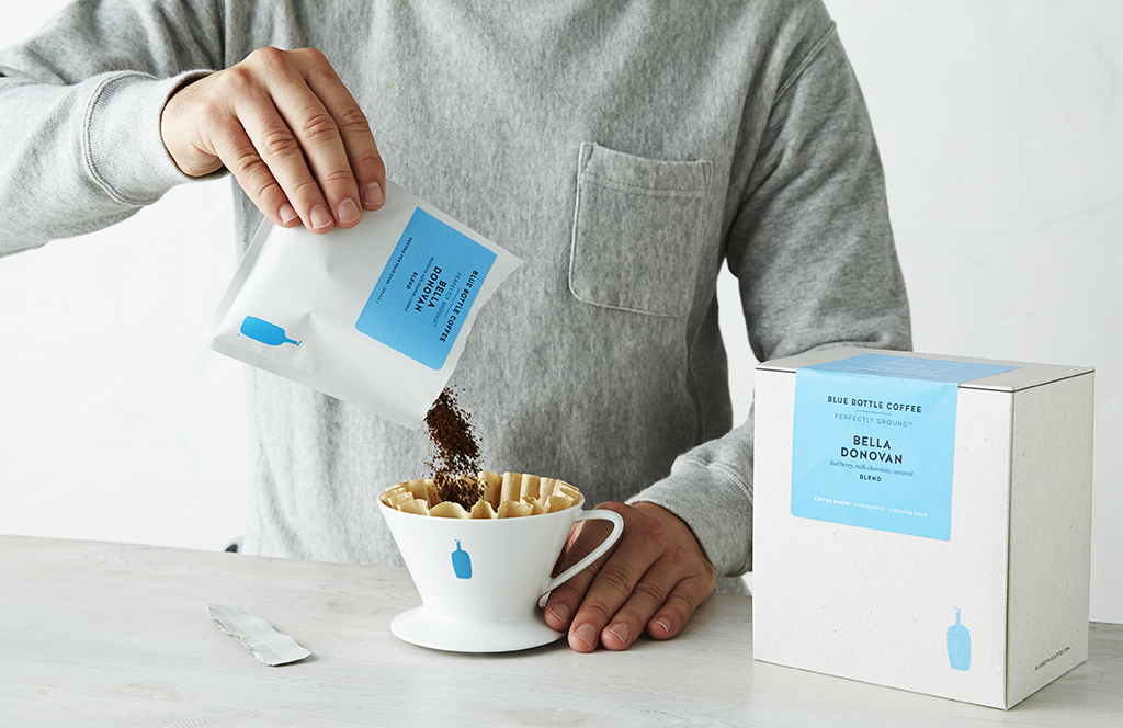 Male Pours Blue Bottle Coffee Gift Into Pour Over