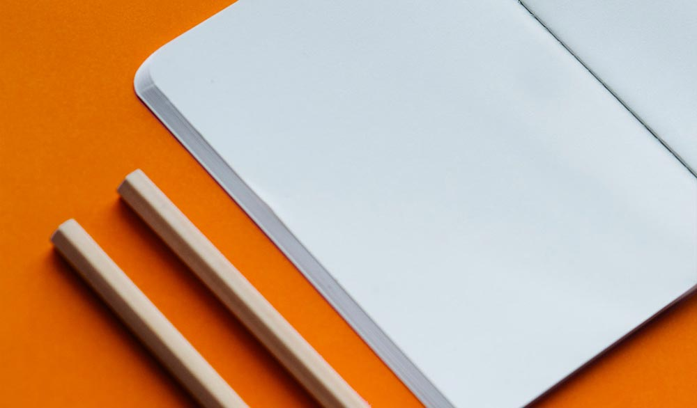 Blank notepad and pens