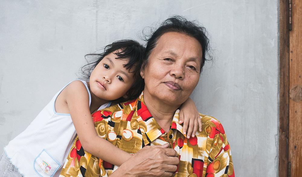 Grandchild Hugging Grandmother
